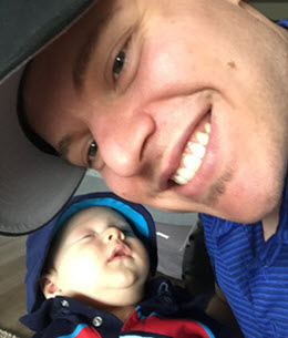 author Cameron King with infant son