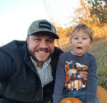 Parker and son at the pumpkin patch